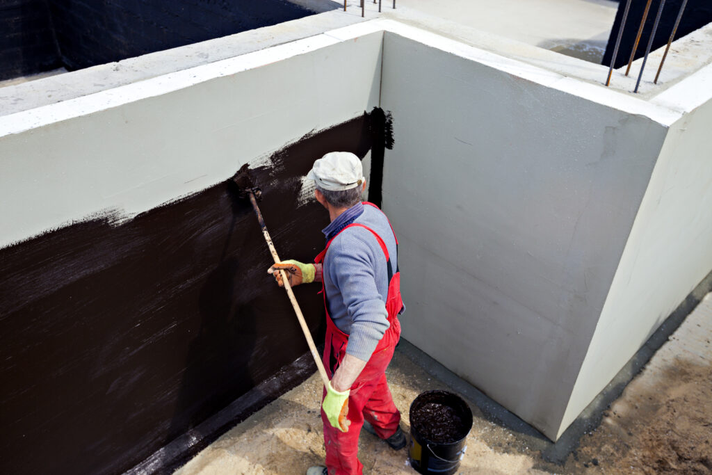 Worker waterproofing below grade